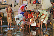 Women wash and perform rituals at the Dashashwamedh Ghat, Varansi, India. Varanasi, India.