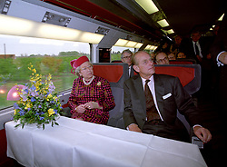 File photo dated 06/05/94 of Queen Elizabeth II and the Duke of Edinburgh travelling on the new Eurostar train. The Royal couple will celebrate their platinum wedding anniversary on November 20.