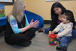United States, Washington, Bellevue, therapist with boy and mother at Kindering Center