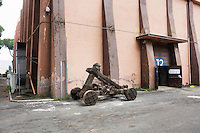 "ROME, ITALY - 30 MARCH 2015: A catapult used for a scene of Ben-Hur, the upcoming American historical epic film directed by Timur Bekmambetov, is here by the Studio 13 of Cinecittà   <br /> in Rome, Italy, on March 30th 2015.<br /> <br /> Italy instated a special 25% tax credit for film productions in 2010. The industry then lobbied to remove the credit's cap, and last July, Italy lifted its tax credit limit from €5 million per movie to €10 million per company per year. <br />  <br /> Cinecittà, a large film studio in Rome, is considered the hub of Italian cinema. The studios were founded in 1937 by Benito Mussolini as part of a scheme to revive the Italian film industry. In the 1950s, the number of international productions being made here led to Rome being dubbed as the ""Hollywood on the Tiber"". In the 1950s, Cinecittà was the filming location for several large American film productions like Ben-Hur, and then became the studio most closely associated with Federico Fellini.<br /> After a period of near-bankruptcy, the Italian Government privatized Cinecittà in 1997, selling an 80% stake.<br /> <br /> Currently Ben-Hur and Zoolander 2 are booked into Cinecittà Studios."