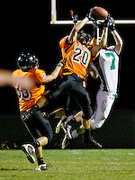 Post Falls High's Tyler Morris elevates in front of Troy Carr from Lakeland High to break up a long pass play Friday during the first half of the Trojan's 42-14 win over the Hawks.