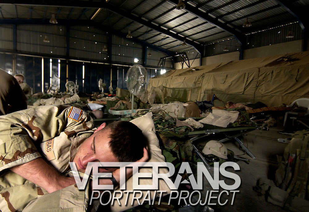 There's peace when soldiers dream. It's a time when they shut out the war. After conducting night-time raids, U.S. Army Sgt. John Williams, tries to sleep inside an abandoned Scavia car dealership while other soldiers keep fighting in Baghdad, Iraq, Oct. 19, 2003.