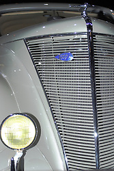 09 February 2005: 1936 Lincoln Zephyr V12.<br /> <br /> Classic Fords range between the Ford DeLuxe and full sized Lincoln. The Lincoln Zephyr was built and produced between 1936-42. The Zephyr was designed by John Tjaarda. The Zephyr was available as a Sedan, Coupe or Convertable. The 1937 model carries red decals as opposed to the blue of 1936, the spare wheel is accessible via the boot lid and there is a quieter fan. Powered by a small side valve V12 of 267 Ci of 110 bhp from 1936-39<br /> <br /> First staged in 1901, the Chicago Auto Show is the largest auto show in North America and has been held more times than any other auto exposition on the continent.  It has been  presented by the Chicago Automobile Trade Association (CATA) since 1935.  It is held at McCormick Place, Chicago Illinois