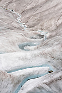 Meltwater creek on the Morteratsch glacier, Engadine, Grisons, Switzerland