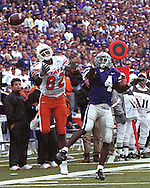 Kansas State defensive back Terence Newman (4) knocks the pass away form Oklahoma State's Rashaun Woods (82) at KSU Stadium in Manhattan, Kansas in 2002.