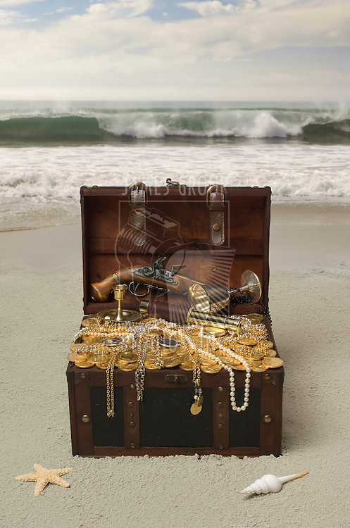 Opened Treasure chest on a sandy beach