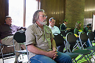 Johnny Heflin looks on during a meeting with the EPA, Army and local residents to discuss the disposal of 15 million pounds of M6 located at Camp Minden in Minden, Louisiana on March 11, 2015. Heflin lives less than two miles from Camp Minden and is afraid some disposal methods will pollute the air and water that could lead to complications for his family and livestock. (Cooper Neill for The New York Times)