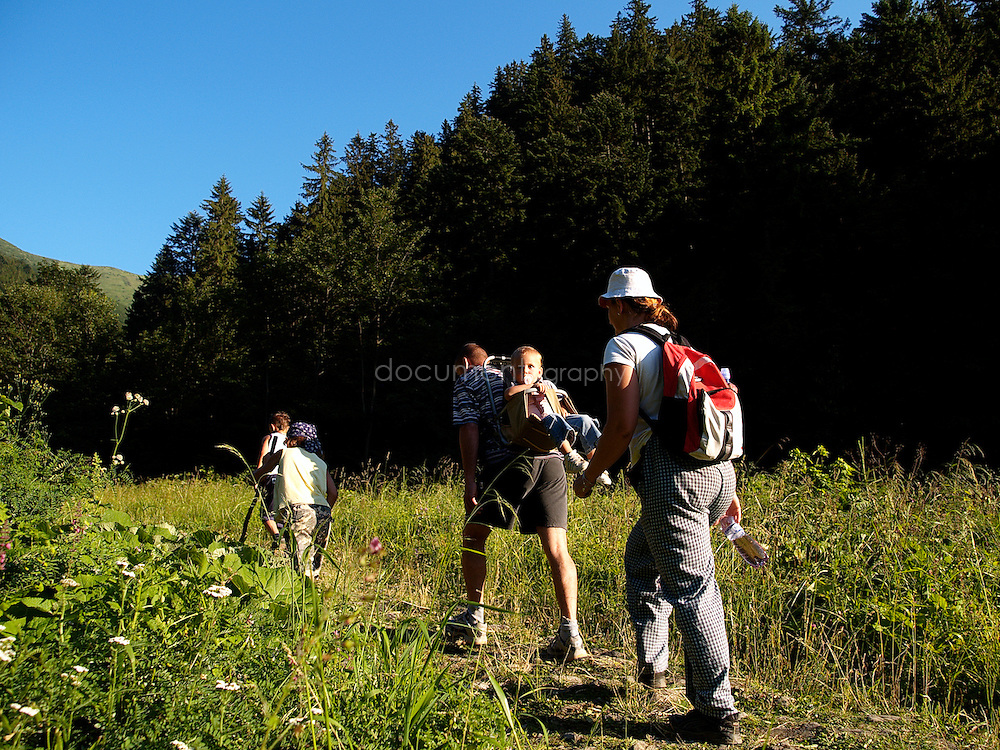 Family walking in Vratna valley, Mala Fatra National Park. Slovakia.
