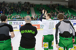 Players of HDD Tilia Olimpija celebrate victory after ice-hockey match between HDD Tilia Olimpija and Moser Medical Graz 99ers in 42nd Round of EBEL league, on Januar 15, 2012 at Hala Tivoli, Ljubljana, Slovenia. HDD Tilia Olimpija defeated Moser Medical Graz 99ers 4:2. (Photo By Matic Klansek Velej / Sportida)