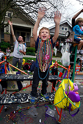 10 February 2013. New Orleans, Louisiana. .Mardi Gras. The Krewe of Thoth, in existence since 1947 parades through Uptown New Orleans. Shouting for beads..Photo; Charlie Varley.