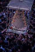 men carry statue of Virgin during celebration of El Rocio in Andalusia, Spain
