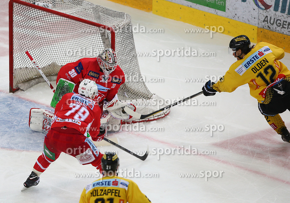 14.04.2019, Albert Schultz Halle, Wien, AUT, EBEL, Vienna Capitals vs EC KAC, Finale, 1. Spiel, im Bild v.l. Mitch Wahl (EC KAC), Lars Haugen (EC KAC) und Sondre Olden (spusu Vienna Capitals) // during the Erste Bank Icehockey 1st final match between Vienna Capitals and EC KAC at the Albert Schultz Halle in Wien, Austria on 2019/04/14. EXPA Pictures © 2019, PhotoCredit: EXPA/ Thomas Haumer
