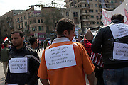 Egyptian volunteers don signs as they head out to clean up the 18 days of protest dust and rubble from the area around Tahrir Square February 12, 2011 in Cairo, Egypt. The day after the revolution toppled the regime of President Hosni Mubarak, Egyptians continued to celebrate and began to focus on rebuilding their city and society. (Photo by Scott Nelson)