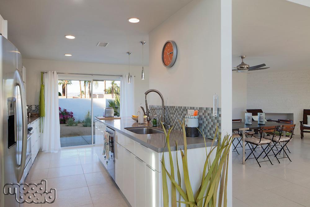 Open kitchen and loving room with slide door to garden