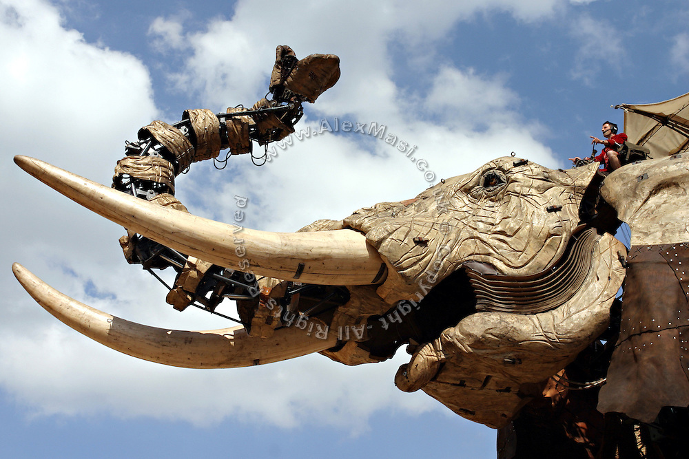 Head of the gigantic mechanical elephant controlled by the Royal De Luxe, on Friday, May 5, 2006. A member of the crew is sitting on it. The Sultan's Elephant show, for the first time in London is a magical, and unique in the world, theatrical show across the streets, performed by an international French company - Royal De Luxe - specialised in constructing and giving 'life' to enormous mechanical puppets. The Sultan's Elephant is the story of a Sultan dreaming of a little girl that travels through time. **ITALY OUT**