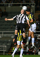 Photo: Andrew Unwin.<br /> Newcastle United v Fenerbahce. UEFA Cup. 19/10/2006.<br /> Newcastle's Peter Ramage (L) competes with Fenerbahce's Onder Turaci (R).