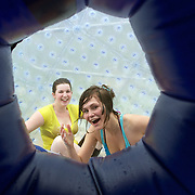 Participants inside a Zorb Globe preparing for a zorb ride down hill. The sport of Zorb globe riding was invented in New Zealand and globes are designed, manufactured and tested there, The Zorb globe is an 11 foot high inflatable transparent sphere which you can ride inside. Two feet of air protect participants from the ground enabling you to globe ride down hills at high speed.  Agrodome, Western Road. Ngongotahaha.  Rotorua, New Zealand, 11th December 2010 Photo Tim Clayton.