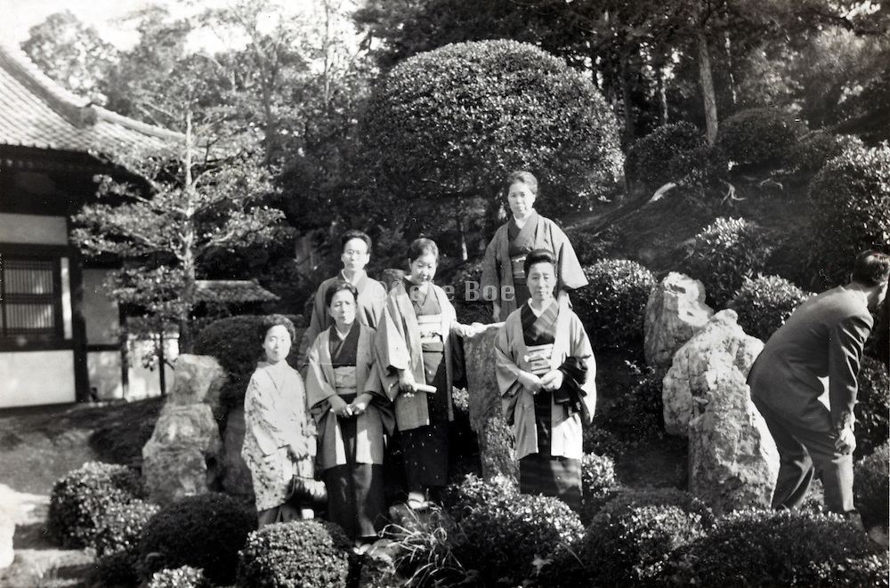 traditional Japanese garden with female group posing early 1960s