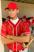 Young baseball player on field (portrait)