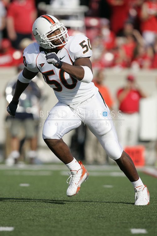 17 SEP 2006:  Miami Hurricanes linebacker Darryl Sharpton drops back in pass coverage during a game against the Louisville Cardinals at Pap John's Stadium in Louisville, KY. (Photo by Brad Schloss)