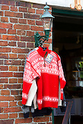 Red jumper, traditional Nordic wool sweaters on sale as gifts and souvenirs at shop in Fano in Denmark