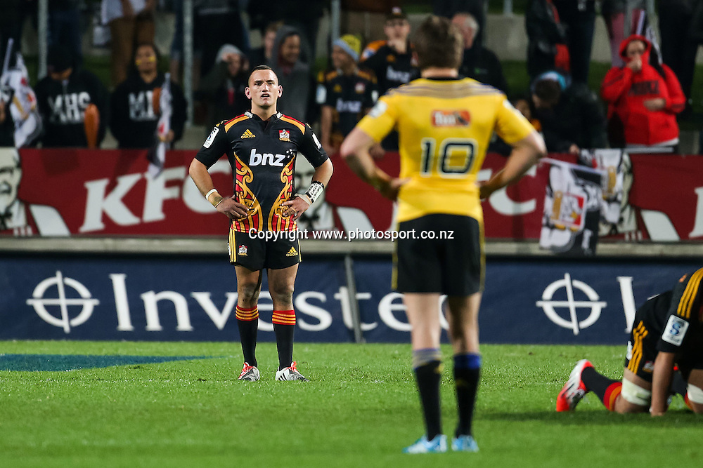 Chiefs captain Aaron Cruden and Hurricanes' Beauden Barrett line up during the Super 15 Rugby match - Chiefs v Hurricanes at Waikato Stadium, Hamilton, New Zealand on Friday 4 July 2014.  Photo:  Bruce Lim / www.photosport.co.nz