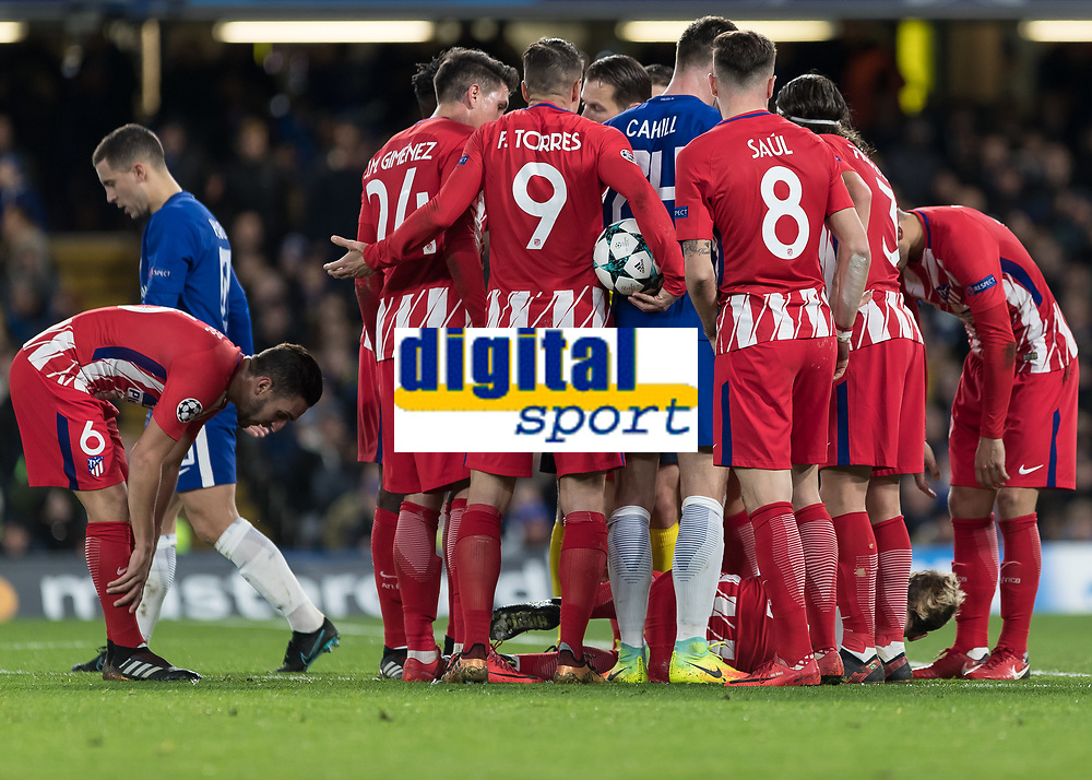 Football - 2017 / 2018 UEFA Champions League - Group C: Chelsea vs. Atletico Madrid<br /> <br /> Atletico Madrid players surround the referee and Gary Cahill (Chelsea FC)  after he fouls Antoine Griezmann (Atletico Madrid) at Stamford Bridge.<br /> <br /> COLORSPORT/DANIEL BEARHAM