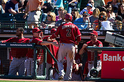 May 30, 2010; San Francisco, CA, USA;  Arizona Diamondbacks second baseman Kelly Johnson (2) is congratulated by teammates after scoring a run during the ninth inning inning against the San Francisco Giants at AT&T Park.
