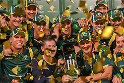 © Licensed to London News Pictures. 08/03/2012. Adelaide Oval, Australia. The winning Australian cricket team pose with the Commonwealth Bank Trophy after defeating Sri Lanka with Injured captain Michael Clarke (centre left) & fill in captain Shane Watson (centre right) holding the winners trophy during the One Day International cricket match final between Australia Vs Sri Lanka. Photo credit : Asanka Brendon Ratnayake/LNP
