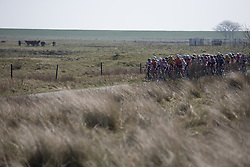 The peloton rides in the first lap of Stage 5 of the Healthy Ageing Tour - a 117.9 km road race, starting and finishing in Borkum on April 9, 2017, in Groeningen, Netherlands.