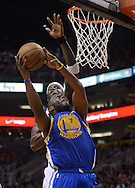 Apr 5, 2013; Phoenix, AZ, USA; Golden State Warriors forward Carl Landry (7) goes up with the ball against defender  Phoenix Suns center Jermaine O'Neal (20) in the first half at US Airways Center. Mandatory Credit: Jennifer Stewart-USA TODAY Sports
