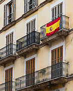 Spanish flag adorns apartment balcony, Palma, Mellorca, Spain.