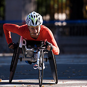 NYTRUN - NOV. 6, 2016 - NEW YORK - Manuela Schar (351), who would go on to finish second in the Pro Wheelchair Women division of the 2016 TCS New York City Marathon, heads into Central Park at 90th Street in Manhattan on Sunday morning. NYTCREDIT:  Karsten Moran for The New York Times **PLS CHECK FINISH PLACE AND TIMES