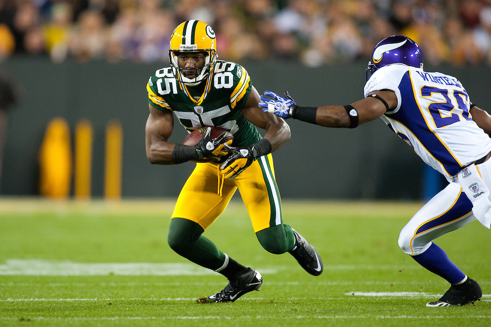 GREEN BAY, WI - NOVEMBER 14: Wide receiver Greg Jennings #85 of the Green Bay Packers runs the ball during the game against the Minnesota Vikings at Lambeau Field on November 14, 2011 in Green Bay, Wisconsin. (Photo by: Rob Tringali) *** Local Caption *** Greg Jennings