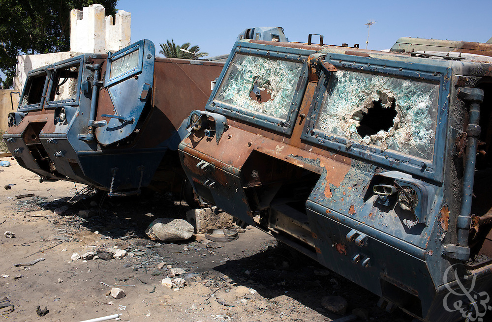Burnt and broken Egyptian police vehicles damaged during the January revolution remain standing on the lot of a destroyed police station July 26, 2011  North Sinai town of Rafah, Egypt. Since the Egyptian revolution, a decline in the number of police across the Sinai has resulted in a boom in the smuggling business and a spate of bombings targeting the natural gas export pipeline to neighboring Israel..Slug: Sinai.Credit: Scott Nelson for the New York Times