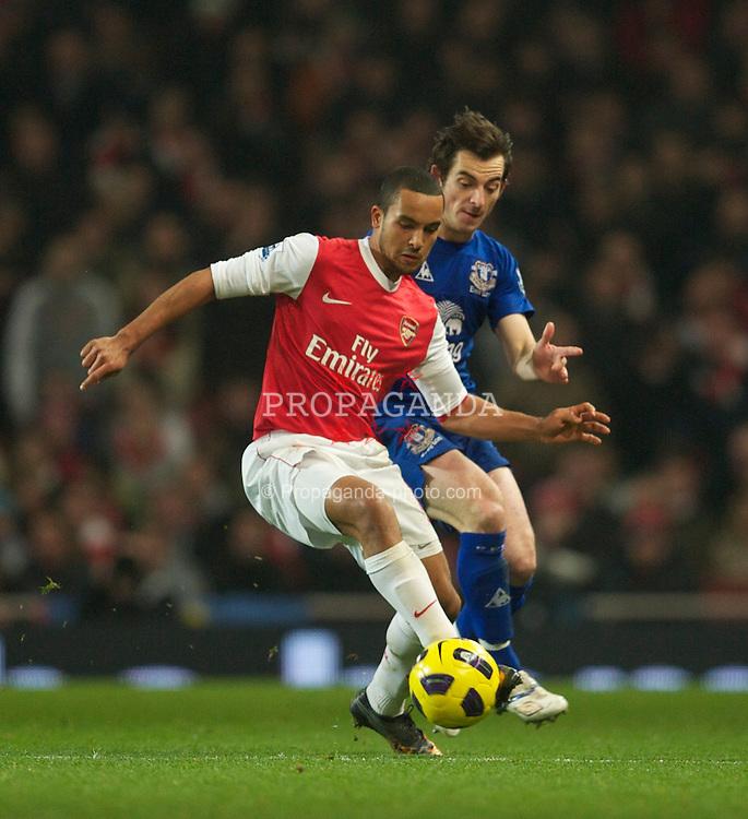 LONDON, ENGLAND - Tuesday, February 1, 2011: Everton's Leighton Baines and Arsenal's Theo Walcott during the Premiership match at the Emirates Stadium. (Photo by David Rawcliffe/Propaganda)