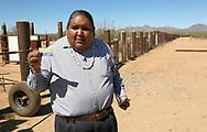 Verlon Jose, vice-chairman of the Tohono O'odham Nation, holds his tribal ID card on the U.S. - Mexico border on the Tohono O'odham reservation in Chukut Kuk, Arizona April 6, 2017. Picture taken April 6, 2017.  REUTERS/Rick Wilking