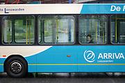 Waiting for the bus to leave at the central station of Leeuwarden during a wet day // Een vrouw zit op een druilerige dag in een bus van Arriva op het busstation in Leeuwarden te wachten tot deze vertrekt.