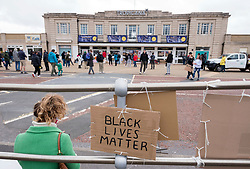 © Licensed to London News Pictures; 06/06/2020; Weston-super-Mare, UK. A Black Lives Matter event at Weston Tropicana in memory of George Floyd a black man who was killed in Minneapolis in the US by a white police officer kneeling on his neck for nearly 9 minutes. The killing of George Floyd has seen widespread protests in the US and other countries, despite the restrictions and social distancing due to the Covid-19 coronavirus pandemic. People were invited to bring signs and placards to Weston seafront promenade outside the Tropicana, in a relatively open space in order to maintain social distancing. Photo credit: Simon Chapman/LNP.