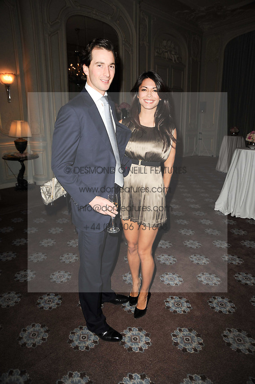 The HON.WILL ASTOR and his wife LOHRALEE at a party to celebrate Penguin's reissue of Nancy Mitford's 'Wigs on The Green' hosted by Tatler at Claridge's, Brook Street, London on 10th March 2010.