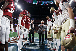 Atlanta Falcons owner Arthur Blank flips the coin prior to the Chick-fil-A Kickoff NCAA football game between the Florida State Seminoles and the Alabama Crimson Tide on Saturday, September 2, 2017, in Atlanta. (Paul Abell via Abell Images for Chick-fil-A Kickoff Game)