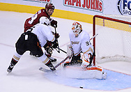 Mar. 2, 2013; Glendale, AZ, USA; Anaheim Ducks goalie Viktor Fasth (30) stops the puck against the Phoenix Coyotes in the third period at Jobing.com Arena. The Coyotes defeated the Ducks in a shootout 5-4. Mandatory Credit: Jennifer Stewart-USA TODAY Sports