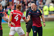 Shaun MacDonald of Rotherham United shakes hands with Bolton Wanderers Manager Kieth Hill after the EFL Sky Bet League 1 match between Rotherham United and Bolton Wanderers at the AESSEAL New York Stadium, Rotherham, England on 14 September 2019.
