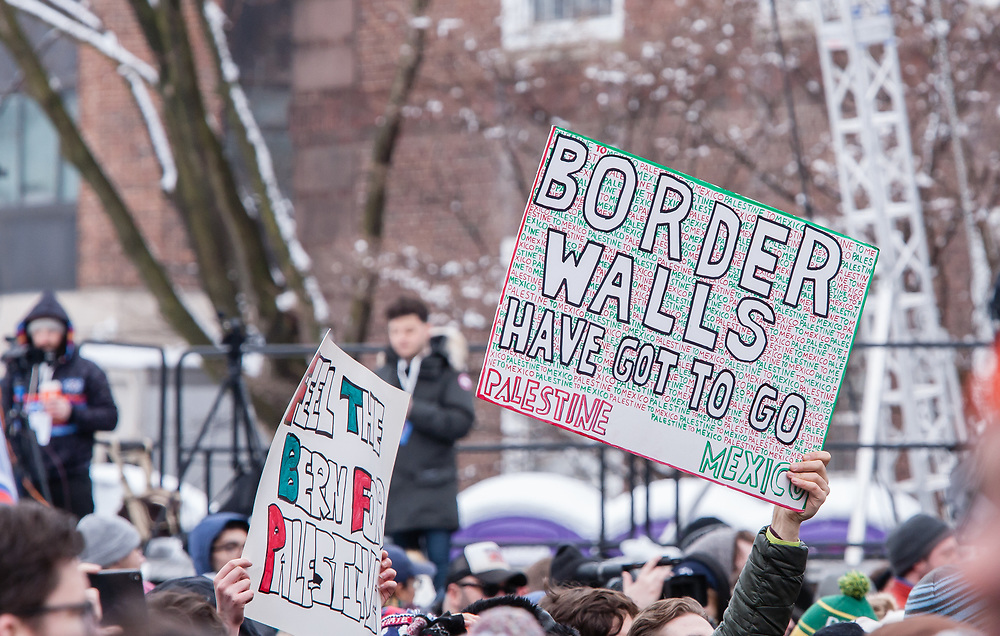 "Brooklyn, NY - 2 March 2019. Signs at Bernie Sanders' first rally for the 2020 presidential primary at Brooklyn College included ""Border Walls Have Got to Go"" and ""Feel the Bern for Palestine."""