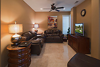 Living room with flat panel monitor television in manor house