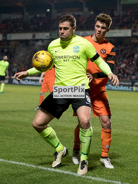 Dundee Utd v Hibernian   SPFL season 2016-2017  <br /> <br /> Grant Holt (Hibernian) and Sean Dillon ((Dundee Utd captain) during the Ladbrokes Championship match between Dundee Utd &amp; Hibernian at Tannadice Park Stadium on Friday 2 December 2016<br /> <br /> Picture: Alan Rennie