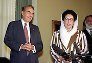 US Senate Majority Leader Robert Dole with Pakistan Prime Minister Benizar Bhutto following a meeting on Capitol Hill April 6, 1995 in Washington, DC.