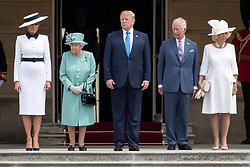 © Licensed to London News Pictures. 03/06/2019. London, UK.  First Lady Melania Trump, Queen Elizabeth II, US President Donald Trump, The Prince of Wales and Camilla, Duchess of Cornwall attend a ceremonial welcome at Buckingham Palace. The visit is on the first day of a three day state visit. Photo credit: Ray Tang/LNP