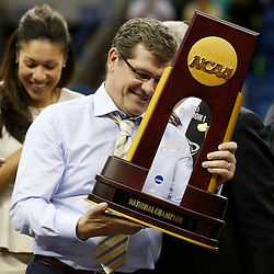Apr 9, 2013; New Orleans, LA, USA; Connecticut Huskies head coach Geno Auriemma receives the championship trophy after the championship game in the 2013 NCAA womens Final Four against the Louisville Cardinals at the New Orleans Arena. Connecticut defeated Louisville 93-60. Mandatory Credit: Derick E. Hingle-USA TODAY Sports