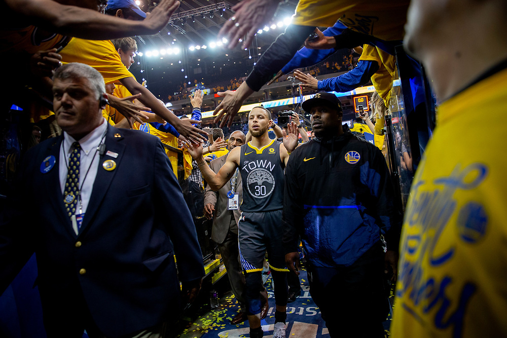 Golden State Warriors guard Stephen Curry (30) greets fans as he exits to the locker room following the end of the fourth quarter of Game 2 of the NBA Western Conference semifinals between the Golden State Warriors and New Orleans Pelicans at Oracle Arena, Tuesday, May 1, 2018, in Oakland, Calif. The Warriors won 121-116.